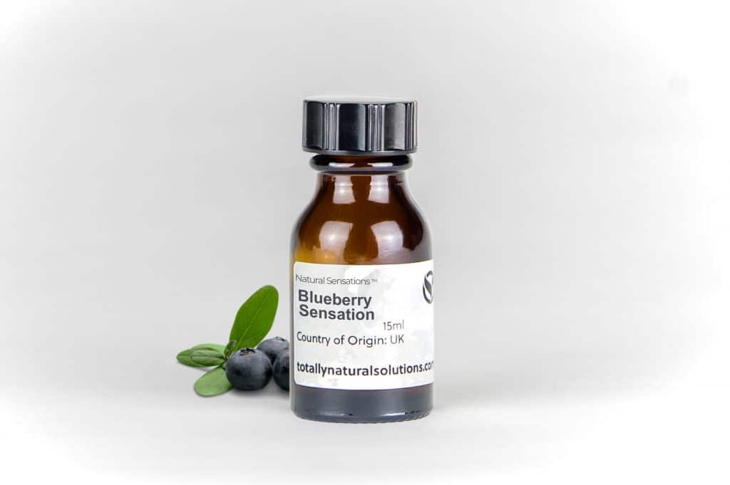 Brown 15ml glass bottle of 'blueberry sensation' with blueberries